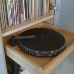 I build this out of an old turntable platter, VPI record cleaner nozzle, and a 1hp wet/dry shop vac!
